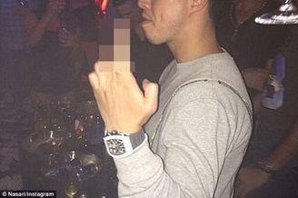 纳斯里夜店竖中指引大麻烦 火爆女友出面反击(图)